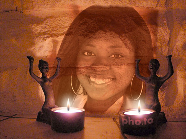 Photo montage with african statuettes and candles